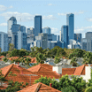 Melbourne city skyline in the distance and house roofs in the foreground